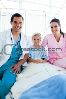 A doctor and a nurse with their little patient