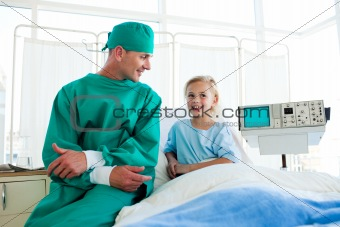 Attractive surgeon explaining a surgery to a child patient
