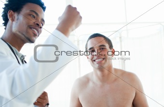 Afro-american doctor checking patient's temperature