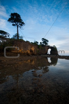 Sky & Mirrored Natural Bridge Arch On Andaman Islands, India