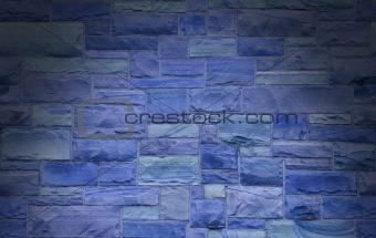 Blue masonry wall lit dramatically