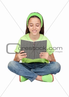 Adorable little girl reading a book