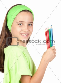 Adorable little girl with many colored pencils