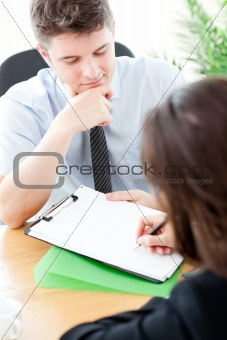 Charismatic  businessman showing a contract to a customer