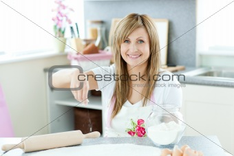 Attractive woman cooking cakes in the kitchen