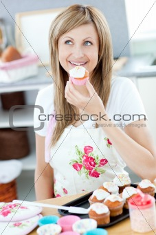 Bright woman preparing cakes in the kitchen