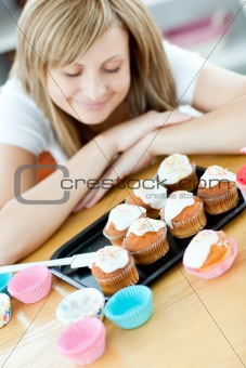 Caucasian woman preparing cakes in the kitchen