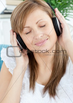 Attractive woman listening music with headphones