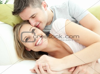 Cute lovers having fun together in the living-room