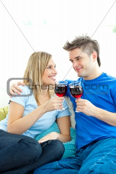 Beautiful couple drinking wine together in the living-room