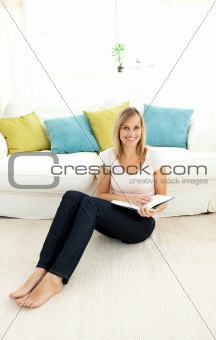 Cute woman reading a book in the living-room
