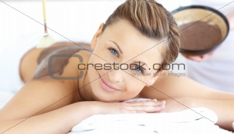 Cute woman having a massage in a spa