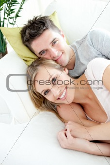 Beautiful lovers having fun together on a sofa