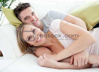 Smiling lovers having fun together on a sofa