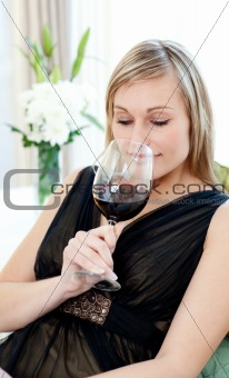 Charming blond woman drining red wine