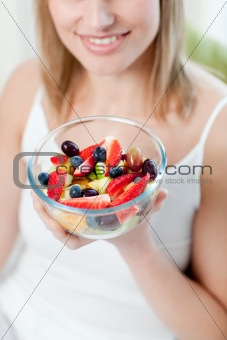 Attractive woman eating a fruit salad
