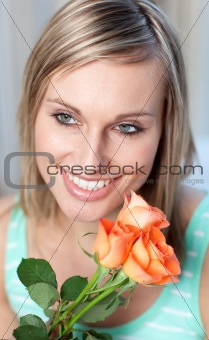 Portrait of a glowing woman holding roses