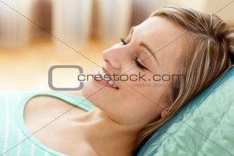 Beautiful woman lying on sofa