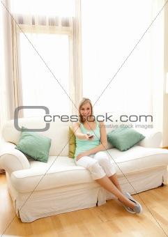 Caucasian woman watching TV