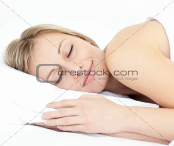 Radiant woman sleeping on her bed