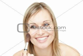 Bright woman using a powder brush