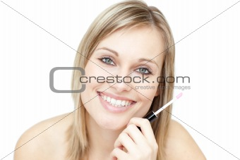 Portrait of an attractive woman holding a lipstick