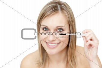 Bright woman putting mascara