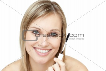 Beautiful woman holding a mascara
