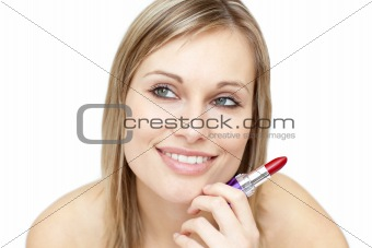 Attractive woman holding red lipstick