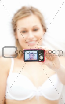 Beautiful woman taking a picture of herself