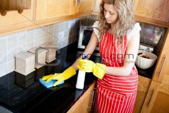 Charming woman doing housework