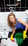 Angry woman in a bathroom cleaning the ground