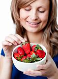 Caucasian woman eating strawberries