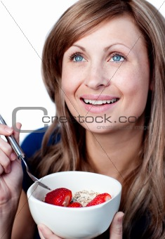 Beautiful woman having a healthy breakfast