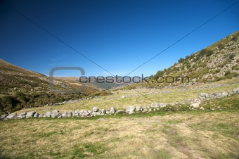 slope full of stones walls