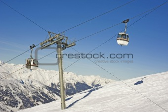 Cabin cars over a ski slope