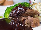 Camel steak in chocolate sauce
