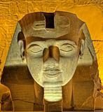 Ramses II head at Luxor Temple at night