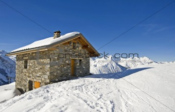 Small mountain hut on a ski slope