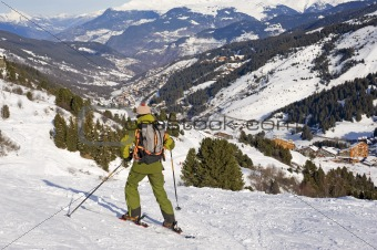 Skier looking at view of a mountain valley
