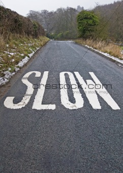 Slow sign on a country lane