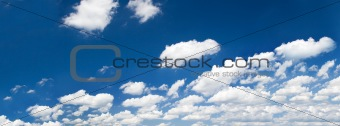 bright summer sky with cumulus clouds