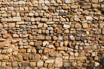 Old stone wall in Faro, Portugal