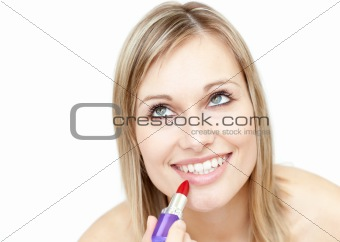 Attractive blond woman putting lipstick
