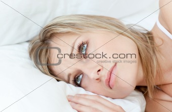 Beautiful woman relaxing lying on her bed