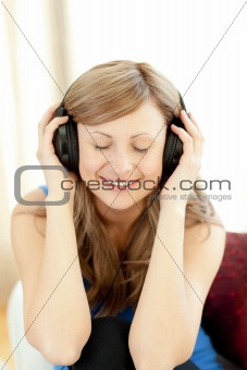 Cute woman is listening the music in the living-room