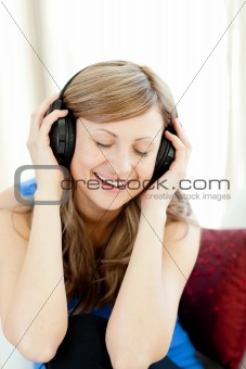 Beautiful woman is listening the music in the living-room