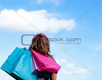 Caucasian woman holding shopping bags outdoor