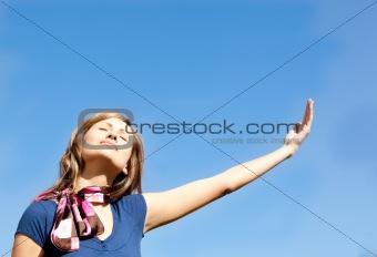 Beautiful  blond woman against blue sky