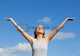 Beautiful woman relaxing against blue sky